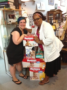 Portia Sam and friend with stack of Huggies diapers