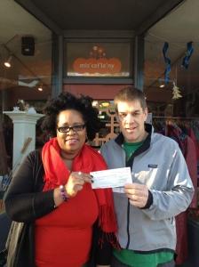 Warren Bentz from OddFellows giving Portia Sam a cheque